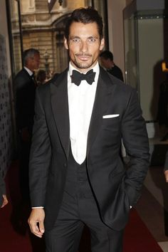 Christian's bespoke Dinner suit made by Henry Poole & Co. Ana made a bold choice by pairing the vest/waistcoat with a long tie instead of the customary bow tie worn here by David Gandy. David Gandy Style, David James Gandy, Tuxedo Wedding, Wedding Suits, Wedding Rings, Wedding Dresses, Traje Black Tie, Traje A Rigor, Famous Male Models
