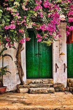 Green Door + Fuchsia Bougainvillea. Old World + Stone + Tropical