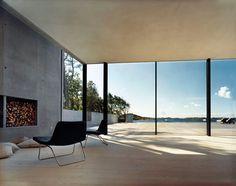 concrete fireplace, wood floors