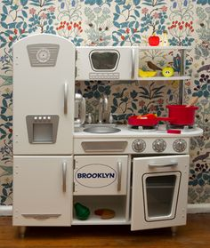 Great toddler Christmas gift idea: Personalized Vintage Play Kitchen! Like the idea of adding Last name so it can be passed down.