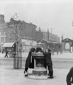 photograph of Drinking Fountain, Mile End Road, near Jubilee Street, around 1900 Vintage London, Old London, London People, Irish Catholic, East End London, Bethnal Green, Drinking Fountain, London Life, Ancestry