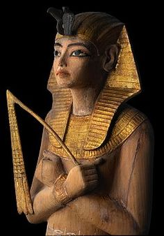 Shabti from tomb of Tutankhamun  Shabti in nemes with shabti spell, wood, gessoed, gilded and painted. | Located in: Egyptian Museum, Cairo.