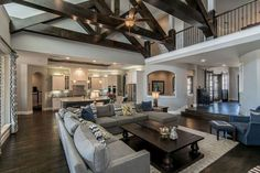 Luxury living room with vaulted ceiling dark wood floors and open to kitchen