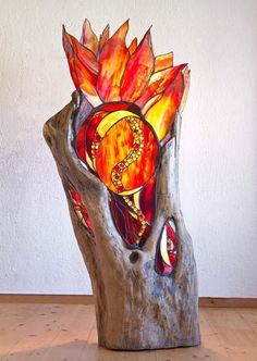fire tree ! Great use of natural materials combined with stained glass. By http://perditasglassart.com/ from Corfu.