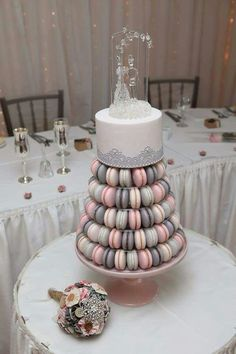 Top off your macaron tower with a petite cake. It'll be perfect to share with your wedding party.