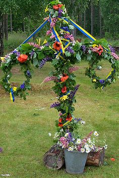 MikQuattro --  Maypole at Midsummer  -  comment from another pinner -- Nobody in Sweden knows the real symbolism.  It's a pre-Christian tradition though - the cross is just a thin veneer of Christianity - so is the Christian name for the day 'Saint John's Day.  There is plenty of folklore surrounding the day - Traditionally minding people attend an official celebration on the day - other's party all night long, as it doesn't get dark..