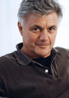 John Irving.  The World According to Garp, especially the opening scene, blew me away.  It was the ultimate in anonymous sex for the sole purpose of getting pregnant.  Irving's themes of love and loss run throughout his works.