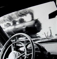 Steam #locomotive charging past a level crossing seen over a 50s car steering wheel. #Art #togs