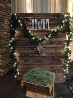 DIY Christmas photo op! Pallets or reclaimed wood draped with lit greenery. No tutorial, but I think it's pretty self-explanatory and easy!