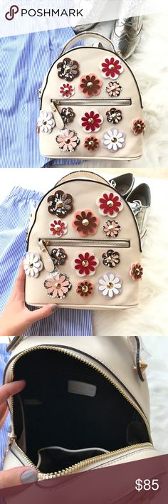 """NWT STYLISH BACKPACK New with tags super cute backpack. Vegan leather. Fabric interior with 2 pockets and 1 outside. Adjustable straps. 4 metal feet on bottom.         10.5"""" x 9"""" x 4.5""""  Boutique brand   SAME/next day shipping Bags Backpacks"""