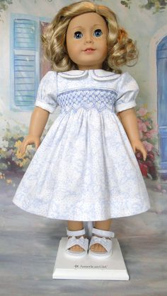 Dress with dainty blue print hand smocked with blue embroidery floss. The classic feather stitch is hand embroidered on the collar, by dancingwithneedles on Etsy  $42.00