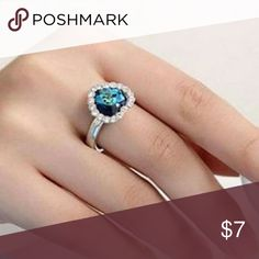 New Blue Crystal Silver Heart Fashion Ring New. Rhinestone crystal embellished cluster heart silver fashion ring. Color: Blue/Silver. Metal: Silver Plated. Size: 7 (adjustable). Item#: R004 Jewelry Rings