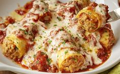 Olive Garden Sausage Stuffed Giant Rigatoni - Large rigatoni pasta filled with Italian sausage, topped with meat sauce and melted mozzarella.