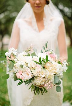 Brides.com: . For their spring-inspired wedding in Dallas, Texas, Brittany and Richard wanted their décor to be filled with light and neutral hues with pops of color. The bride's bouquet, created by Lush Couture Floral, was made up of garden roses, ranunculus, peonies, spray roses, and dusty miller in shades of white and pink.