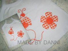 Camiseta em ribana com aplicação em tecido e feltro.