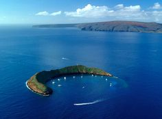 Must try! The Crescent-Shaped Molokini Crater just off of Maui in Hawaii is an amazing snorking location. Photo by Ron Garnett/Hawaii Tourism Authority.