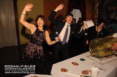 "Rodan + Fields CEO Lori Bush and Chairman Amnon Rodan doing ""the Amnon"" dance at Convention 2010"