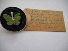 Pillsbury's Pieces No, 171. Pin - dark green capsule with khaki green paper butterfly. In exchange for a donation to KATHMANDU ANIMAL TREATMENT CENTRE, Nepal. Available at St. George's Church, Madrid on Saturday 13 June from 11.00 - 15.00.