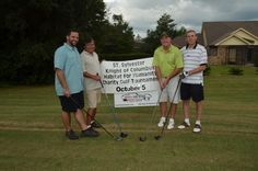 St. Sylvester Knights of Columbus Charity Golf Tournament supporting the Pensacola Habitat for Humanity. This is team Navarre Auto Repair standing in front of their tee sponsor banner.