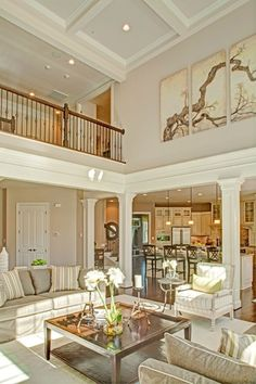 Traditional Living Room with Crown molding, High ceiling, Hardwood floors, Box ceiling, Columns, Balcony