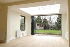 Glass roof lantern and fully opening, glazed, concertina doors Orangery Roof, Kitchen Orangery, Glass Extension, Rear Extension, Extension Ideas, Lantern Roof Light, Single Storey Extension, Kitchen Diner Extension, House Extensions