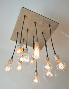 Industrial Style Chandelier Light Fixture made from reclaimed wood & Edison bulbs.