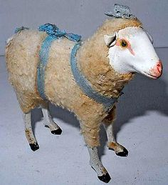 19th. CENTURY TOY - SHEEP MADE OF PAPIER MACHE AND COVERED IN A FUZZY AND WOOLY FABRIC.
