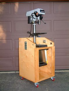 A two foot square mobile cabinet that has a pivoting top so two tools can be supported.    This cabinet was featured in Wood Magazine's Americas Best Home Workshops 2009.