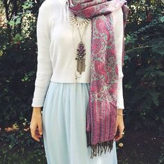 Icy blue skirt, white sweater, pink printed scarf, gold necklaces, silver ring and bracelet