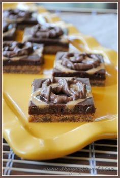 Chubby Hubby Cookie Bars topped with a chocolate fudge, peanut butter drizzle and chocolate covered pretzels. YUM.