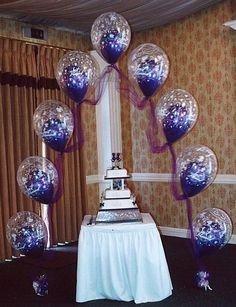 A double bubble balloon arch creates a festive frame for your wedding cake table. #Wedding #BalloonDecorations
