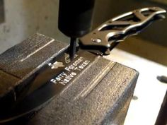 HAAS CNC Mill Engraving on a Gerber Knife Blade using a Carbide Engraver and CNC Mill.