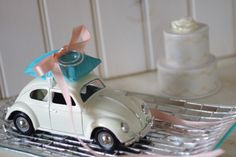 THIS IS SO PERFECT FOR US!!!Wedding Ivory Volkswagon Bug Toy Car Ring by ByTheSeashoreDecor, $54.00