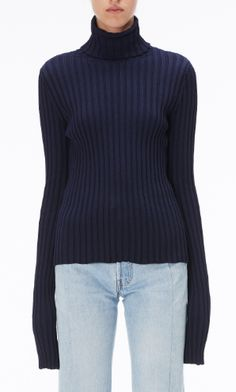 Shop now. The Vogue Edit. Vetements Turtleneck Jumper. VETEMENTS 1ST SEASON navy ribbed-knit turtleneck is given ultra-modern appeal with extra-long sleeves in this reissue.