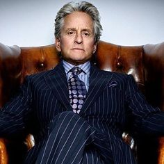 Michael Douglas looking sharp in his suit from Wall Street 2. Fabric woven by Harrison's in England