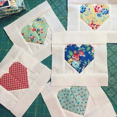 First project of the year. I *need* a heart mini quilt for my wall. I want it to stay up all year, so I'm using #arborblossomfabric by #ellisandhiggs The wonderful tutorial for the heart blocks is by @cluckclucksew and can be found on her website. #quilting #hearts #rileyblakedesigns