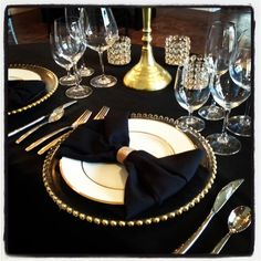 and black sweetheart table- Joli black linens, with gold chargers, gold rim china, silverware, votives and candelabra Black And Gold Centerpieces, Gold Wedding Centerpieces, Wedding Reception Tables, Great Gatsby Wedding, Art Deco Wedding, Wedding Ideas, Gold Table, Black Table, Gold Chargers