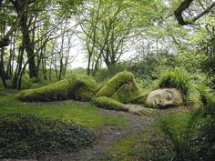 Located on Woodland Walk, in the Lost Gardens of Heligan, is an amazing sculpture of a sleeping goddess entitled 'Mud Maid'. The incredible larger-than-life sculpture even has grass and moss growing atop it.