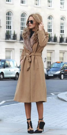 Nada Adelle wears a gorgeous fur trimmed beige overcoat with strappy black sandals and a matching simple tee. This look is ideal for every day sophistication and glamour.   Coat: Primark, Bag: Runway London, Sunglasses: Asos, Heels: Public Desire.