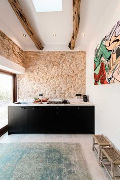 Amsterdam-based Standard Studio has transformed a stable into an off-grid showroom and home for the owners of an interior design shop in Ibiza. Nestled within the mountains at the north of the Balearic island, the 45-square-metre house named Casa Campo comprises two bedrooms and one bathroom.