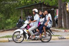 Battambang - Cambodia - The School Bus - By Emanuele Del Bufalo Honestly I have tried to have the opportunity to take this photo from a couple of days. I was looking for an example of how a motorbike can be loaded with people. The best time turned out to be at 1pm when some scooters become the school buses to take home students,