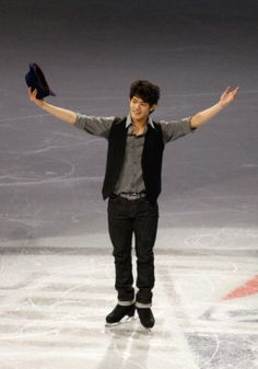 Oct 20, 2013; Detroit, MI, USA; Takahito Kozuka of Japan poses for the crowd during the exhibition following the 2013 Skate America figure skating competition at Joe Louis Arena. Mandatory Credit: Raj Mehta-USA TODAY Sports (1023×1461)