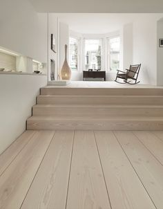 Tiles or ash coloured floor boards?? Or just floor boards in the bak living area???