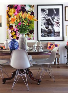 Love the traditional table with the mid century modern chairs. Love it. Try to mix styles, it makes your house look like a home. Biddy Craft