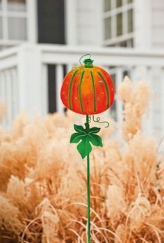 Welcome the seasonal transition to fall with this sparkling pumpkin atop a bright green yard stake. Pumpkin Garden, Garden Plaques, Garden Stakes, Garden Structures, Accent Colors, Green Leaves, Fused Glass, Outdoor Gardens, Vines