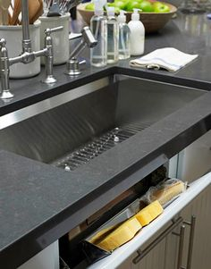 pop out drawer for sponges, etc below sink
