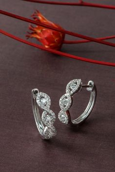 Big night coming up? Bring these stunning swirl hoop earrings as your plus one. #ShaneCo #ShaneCoChic