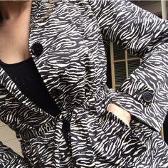 "REDUCED! Foxy zebra short belted trench coat ⚡Love it! Bought it, but it only came in petite...doesn't work for my long arms. 98% cotton/3% spandex exterior, fully lined (polyester). Slit pockets with buttoned flaps, 4 black button front closure, belted. Best worn as part of an outfit, but could be a lightweight overcoat. Length from collar to base: 28"" sleeve length from shoulder to cuff: 24"" Zoe D. Jackets & Coats Trench Coats"