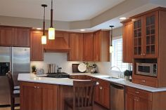 Cherry cabinets and white subway tile