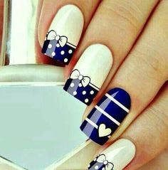white and blue bows and heart nails